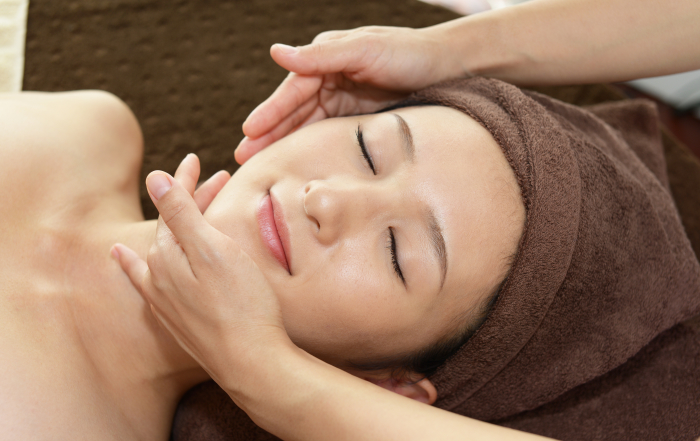 shutterstock_facial for woman in brown towel 375644101